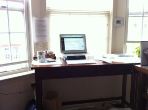 In the spirit of sharing what my writing space looks like, here's my desk, at the window. Not bad, even if it overlooks the parking lot.
